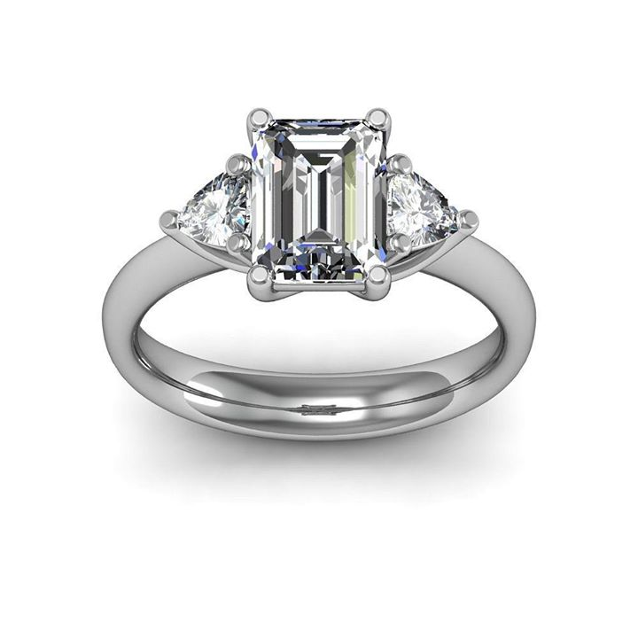 Emerald Cut 3 Stone Diamond Engagement Ring with Trillion Cut diamonds on the side !